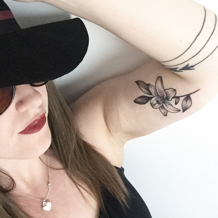 Stargazer lily tattoo by Rebecca Vincent at Parliament Tattoo in London, and triple arrow bracelet tattoo by Ruth Rollins at Red Tattoo in Leeds