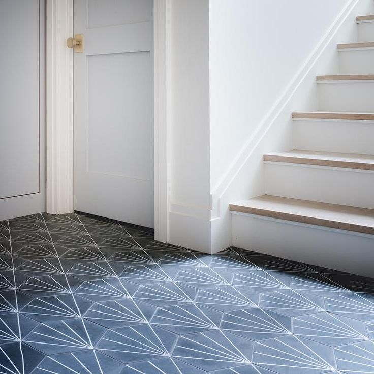 Cement Tile Shop Starburst Hex Black floor tiles lead to powder blue paneled laundry room doors : tile door - Pezcame.Com