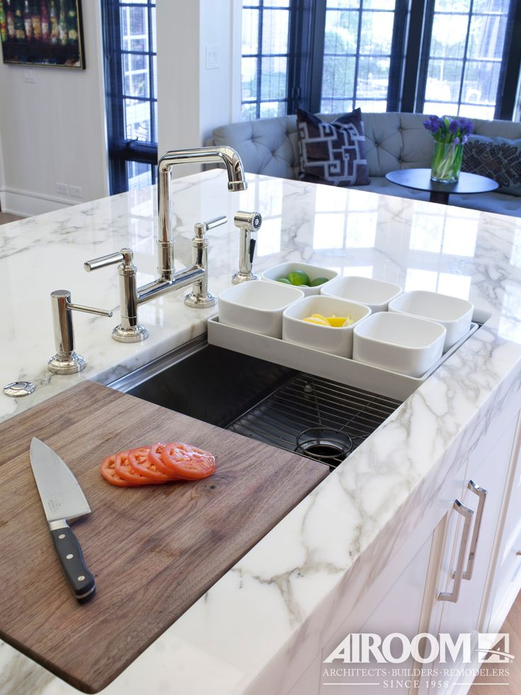 No kitchen remodel is complete without a new kitchen sink. This Winnetka kitchen remodel takes it to the next level with an extra wide basin and a drop-in cutting board | Airoom | www.Airoom.com