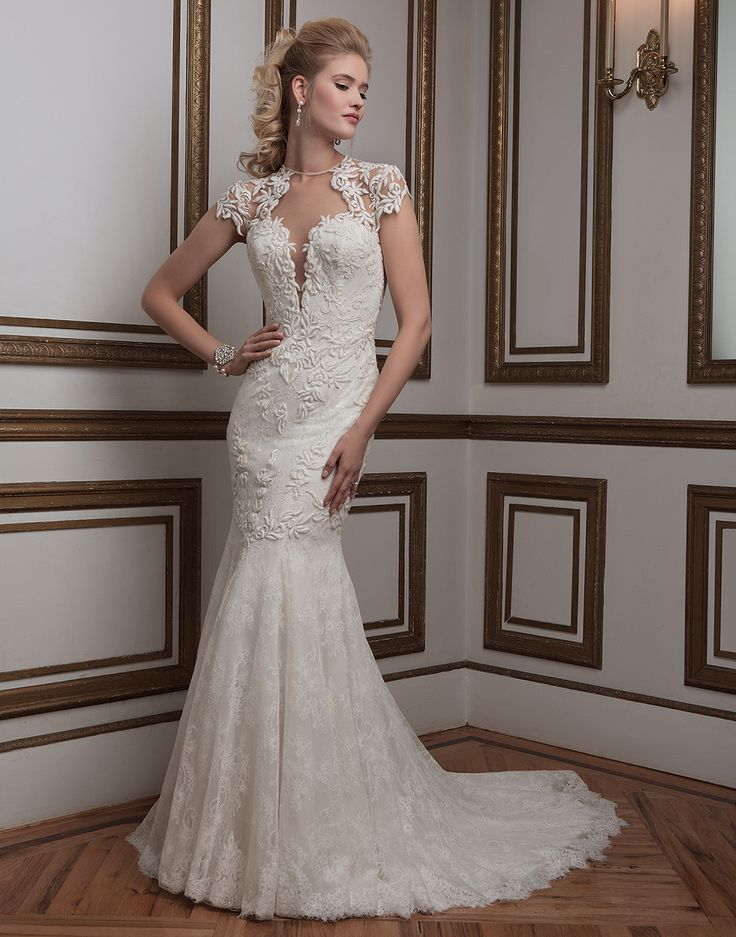 short retro wedding dresses uk%0A Also  a plunging front and back   illusion jewel neckline  short lace  sleeve and a court train