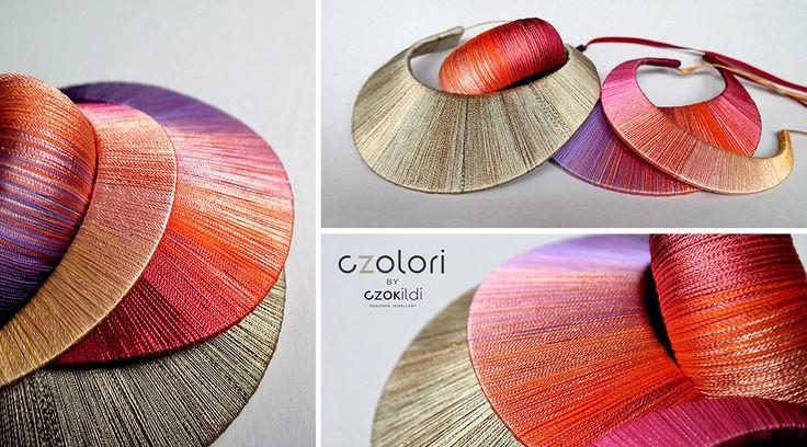 Rainbow yarn wrapped jewellery by Czolori http://czokildihu.bigcartel.com/