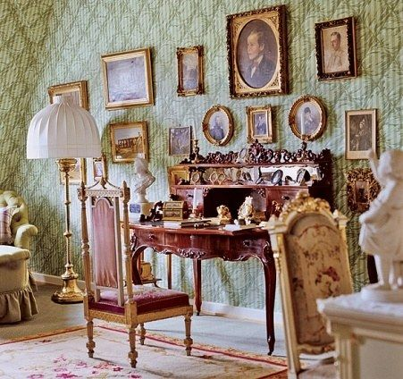 A Victorian desk in an upstairs bedroom stands near portraits of family. The Hessian dynasty started at the beginning of the 13th century when Elizabeth (1207-1231), daughter of a Hungarian king, married Landgrave Ludwig IV of Thuringia (1200-1227).