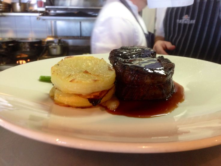 Grilled beef fillet with roast pumpkin and potato gratin, saluted green beans and jus