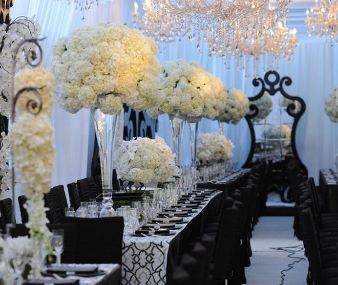 Varying heights of floral arrangements adds interest, Just remember flowers can hinder conversation. Make sure you have clear or thin vases when they are on the tables. No one wants to stare at flowers all night no matter how beautiful.