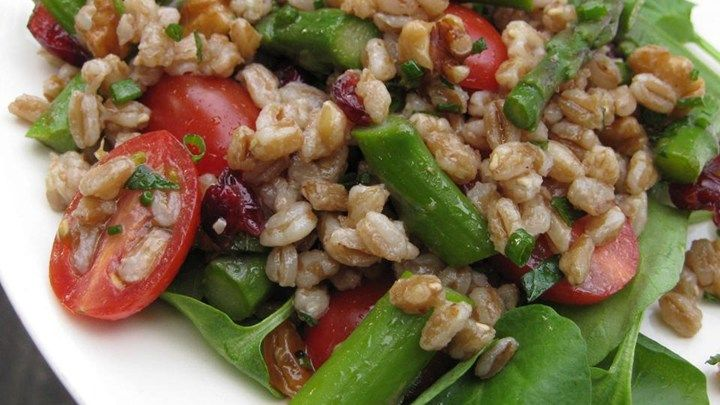 The nutty flavor of farro grain balances with the salty Parmesan and tart cranberries in this tasty salad. Plan ahead, as the farro needs to soak overnight. If you can't find farro, substitute spelt or wheat berries.