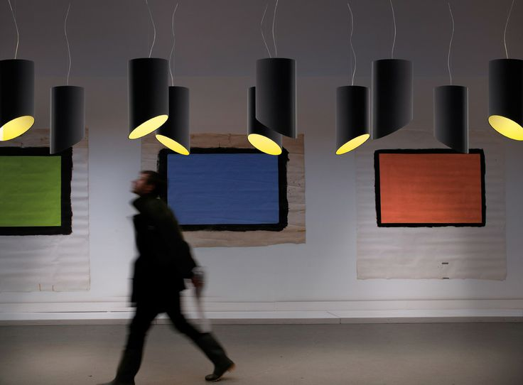 Pank SO30 suspension lamp in black covering fabric with yellow fabric inside.