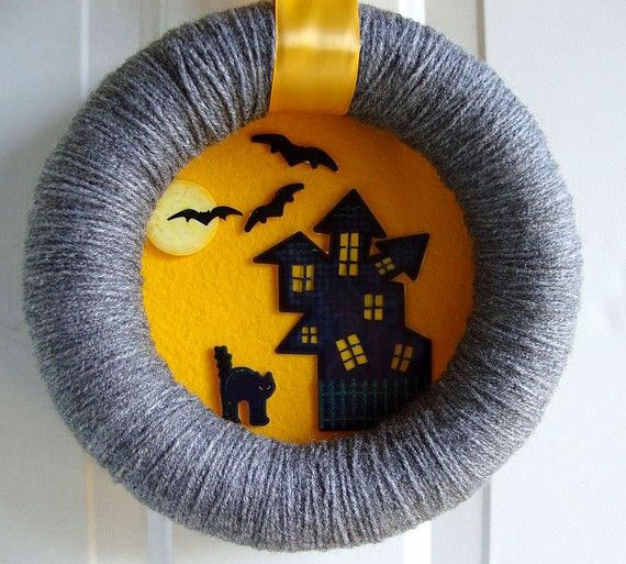 "Halloween wreath- I love the idea of wrapping a wreath in yarn and making it into a ""picture frame"". Could work with any season or decor."