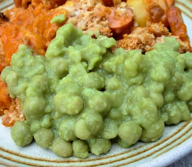MUSHY PEAS. INGRED: 8 ounces dried split marrowfat peas	 (other may be substituted if not available), 1/2 teaspoon baking soda, 3 1/2 cups boiling water, salt, pepper, 1 pinch sugar, butter. DIRECTIONS: Put peas in bowl, add baking soda, pour in boiling water, soak overnight. Next day drain, barely cover the peas with water, bring to boil, simmer until tender (aprox 15-20 mins), drain. Add salt, pepper, pinch of sugar, butter, stir, serve.