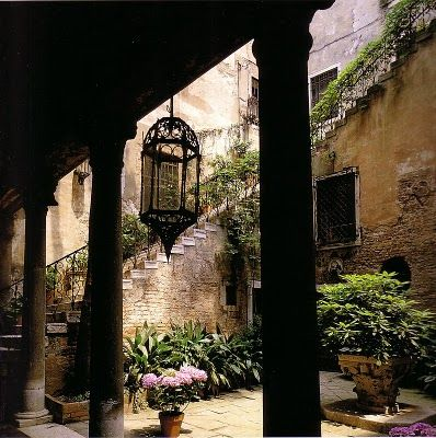 centuries old courtyard large hanging lantern, portico, stairs with plants via: DESDE MY VENTANA: Autumn in Venice
