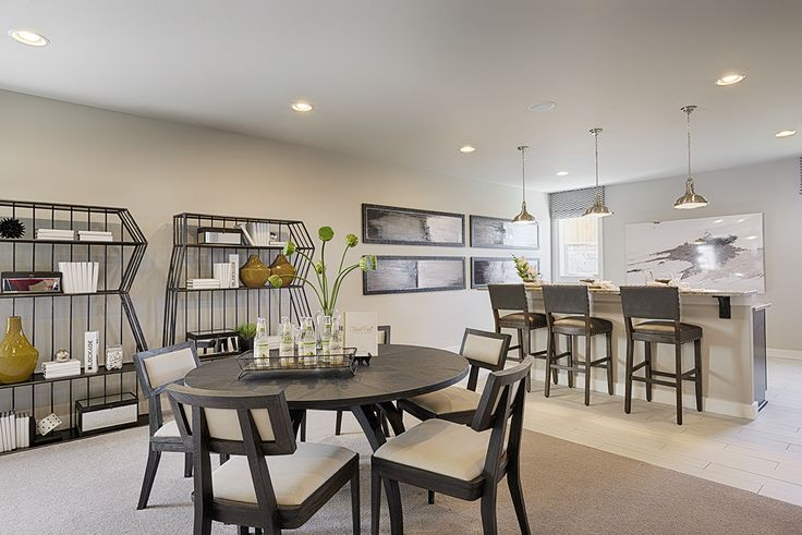 A Contrast Of Light And Dark Creates A Stylish Basement Rec Room | Daley  Model Home