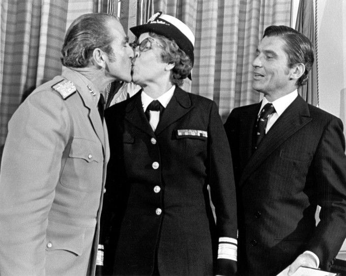 "Washington DC... Chief of Naval Operations Adm. Elmo R. Zumwalt ""Congratulates"" Radm. Alene B. Duerk on her promotion during a ceremony in the office of Secretary of the Navy John W. Warner who looks on at right. Radm. Duerk, Director of the Navy Nurses Corps, The first woman to reach rank of Rear Admiral.VA014577, Admiral Elmo R. Zumwalt, Jr. Collection, The Vietnam Center and Archive, Texas Tech University"