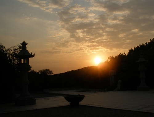 Gorgeous sun sets over peaceful temple in Cheonan, South Korea.
