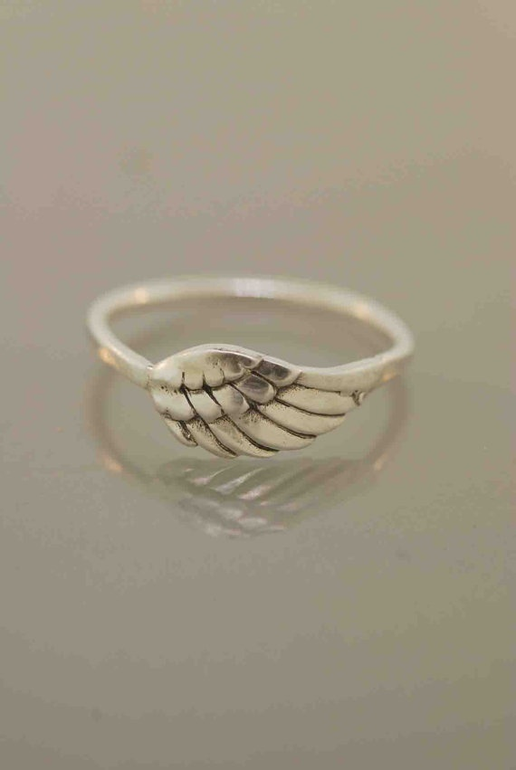 Angel wing ring http://media-cache3.pinterest.com/upload/35465915785672706_8YNLjy58_f.jpg mleslie12 products i love