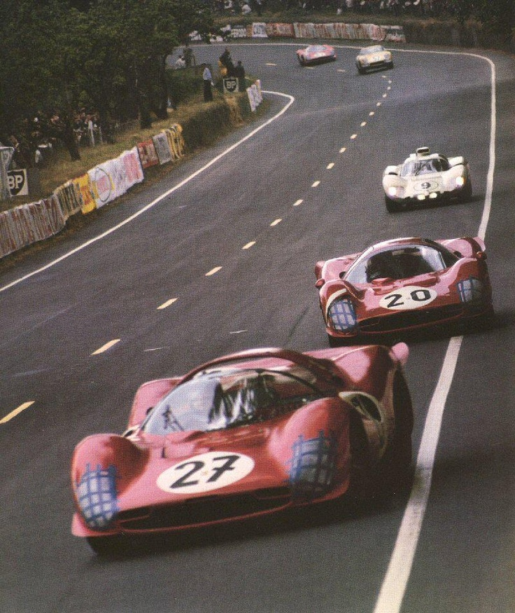 The Ferrari 330 P3 Spyder 27 of Pedro Rodriguez/Richie Ghinter is followed by the 20 of Mike Parkes/Ludovico Scarfiotti at the 24 Hueres du Mans in 1966