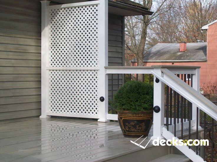 This deck in Robbinsville has the hot tub built in and a custom privacy screen for railing.
