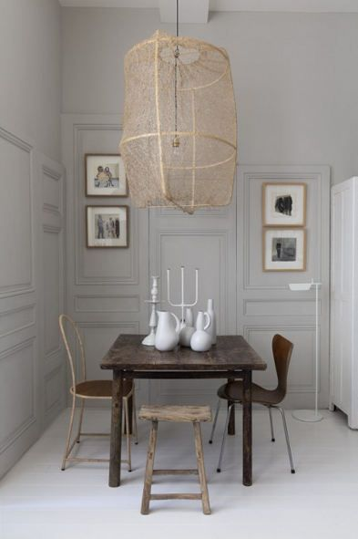 soft, subtle elegance (wall paneling at different heights and proportions) sophisticated palette mixed with various tones and textures in the furniture
