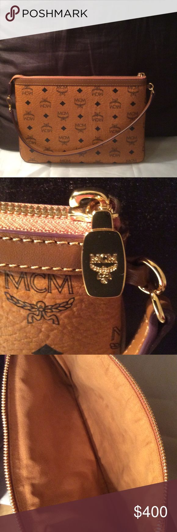 Flash sale!! Authentic MCM leather pouch MCM leather monogram large pouch/ shoulder bag in pristine condition. Soft leather!! No stains or rips. Serial: 10071408..MCM is manufactured in Germany, Korea and Italy!! Look on their website they will tell you. The last pic is just to show you how big the MCM pouch is. MCM Bags