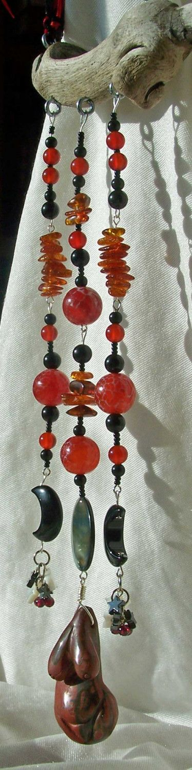 Altars:  Dark Moon's Fire's #Altars on the Wind, Series I » The Goddess is carved of Picasso Jasper. Above her hangs the Triple Dark Moon. The Full Moon is Mother of Pearl; the Crescents are Black Onyx, and from them hang Clusters of Stars - Mother of Pearl, Hematite, and Tiny Garnet Spheres. The dangles are made of Carnelian, Crab Fire Agate, Amber, and Obsidian. The whole hangs from a piece of driftwood, EarthStarStudios.