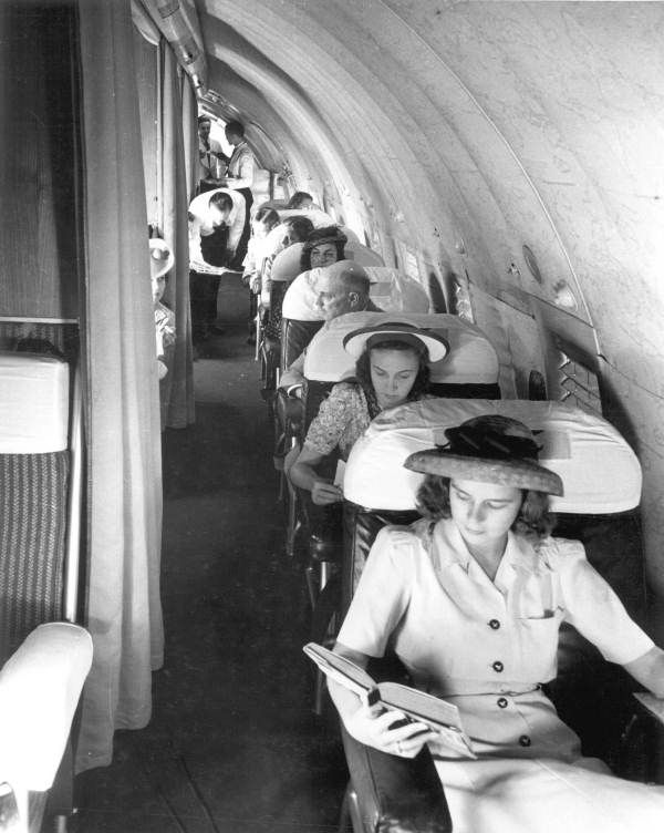 *Passengers aboard a Boeing 307 aircraft operated by Pan American World Airways, between 1940 and 1947  The Boeing Model 307 Stratoliner was the first commercial transport aircraft to enter service with a pressurized cabin. This feature allowed the aircraft to cruise at an altitude of 20,000 ft, well above many weather disturbances. Wikipedia Top speed: 222 mph (357 km/h) Wingspan: 107' (33 m) Length: 74' (23 m)  First flight: December 31, 1938