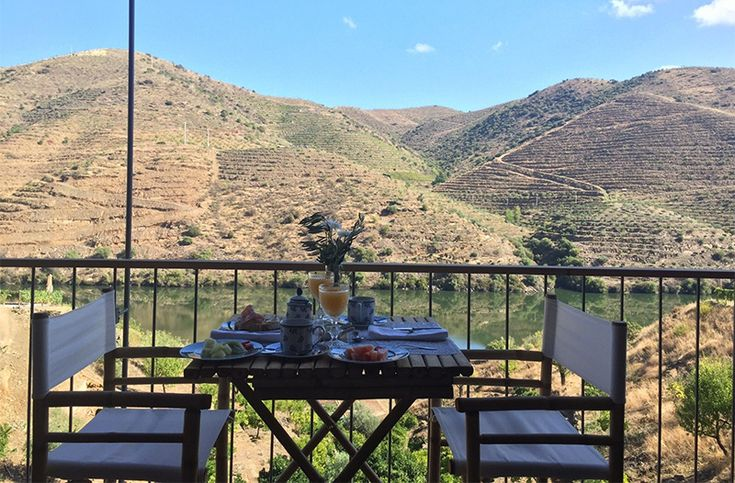 Outside dining with views of the surrounding vineyards at the Casa do Rio, a boutique hotel, as part of the Quinta Do Vallado Winery in Portugal