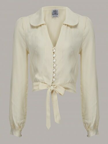 This fab blouse has a very flattering shape with a classic 40'scollar and front tie fastening, finished with cute little domebuttons and gorgeous puff sleeves.