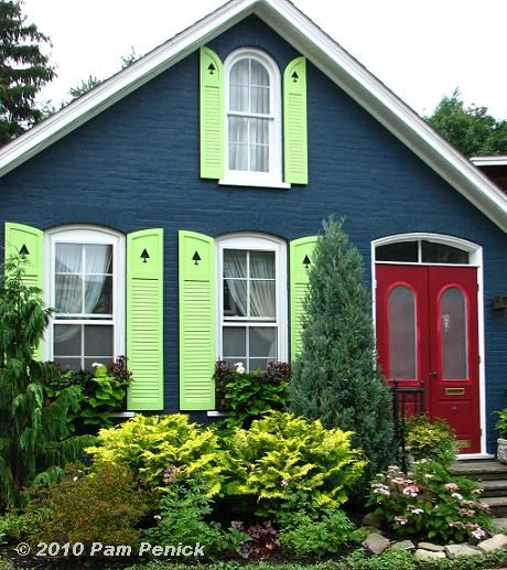 a much more muted version of this-- love the main color and door color, would tone down the shutters    Blue_cottage.JPG (460×517)