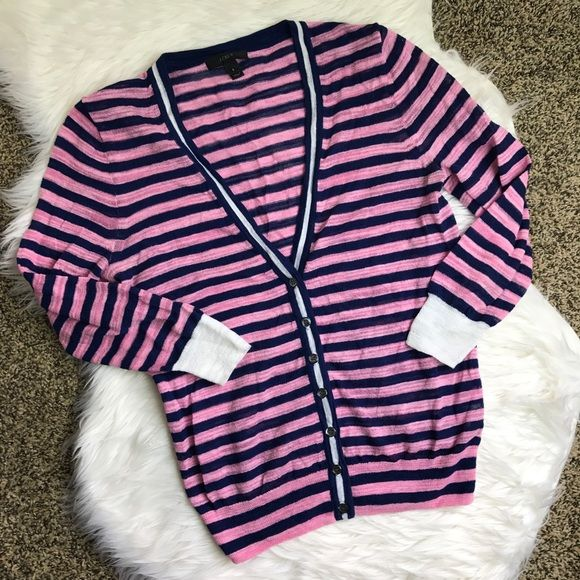 Pink and Navy J. Crew Cardigan Gorgeous nautical cardigan, which is very light and perfect for summer. The colors are a beautiful light pink, navy, and white. Features a button up front so that you can wear it open or closed. J. Crew Sweaters Cardigans