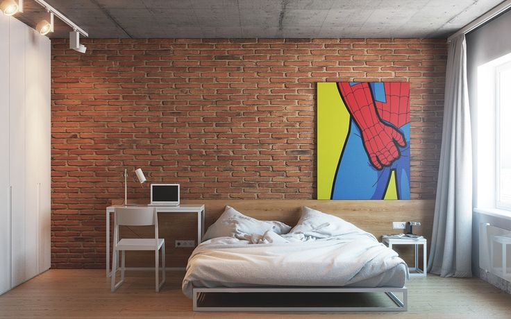 The bedroom is utterly simple with a red exposed brick wall and another version of the cheeky superhero art that we saw in the main living area. Simple matched bedframe, nightstand, and desk give the room a unified feeling that has a calming effect.