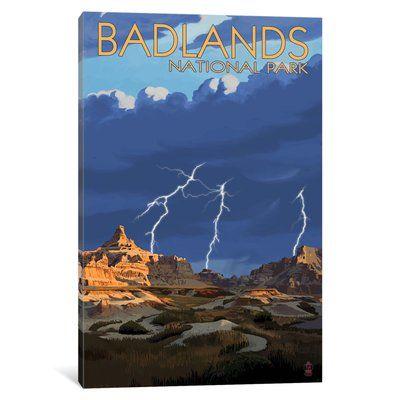 "East Urban Home 'U.S. National Park Service Series: Badlands National Park (Lightning Storm)' Vintage Advertisement on Canvas Size: 18"" H x 12"" W x..."