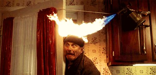 Pin for Later: This Is What the Holidays Look Like According to Home Alone GIFs When you realize the Christmas dinner is burning. You went Pinterest on this Christmas dinner's ass, but you may have taken on more than you could chew.