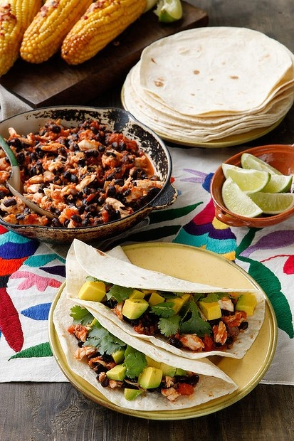 Caroline Velik's tortillas with spicy tomato, fish and black beans. Photo by Marina Oliphant.