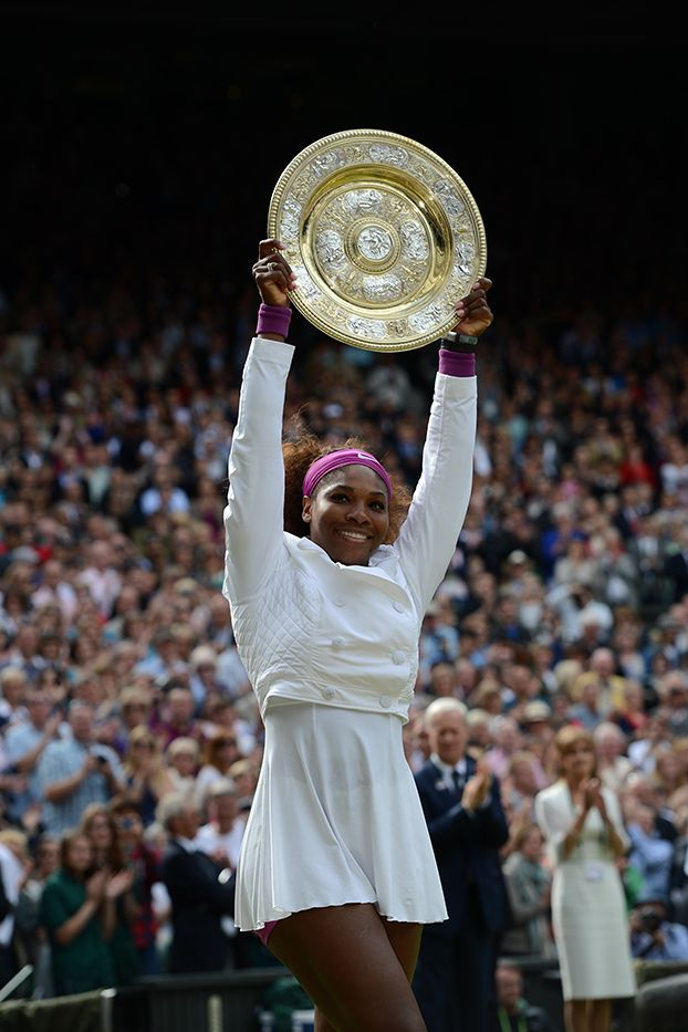 2012 Wimbledon Champion Serena Williams holds up the Venus Rosewater Dish. - Matthias Hangst/AELTC