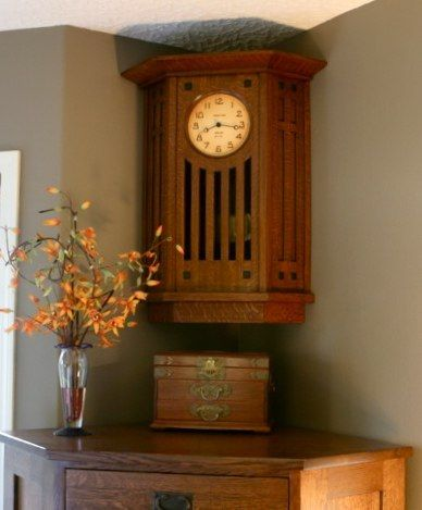 A corner wall clock.  Arts and Crafts, Craftsman, Clocks.  Oak.  Choice of Movements, Faces, Woods & Finishes.  http://www.present-time-clocks.com