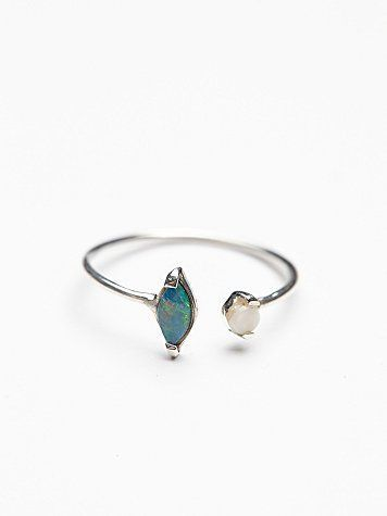 Delicate sterling silver ring with two petite exotic opals stones, each set to look like it's floating. Adjustable to fit any finger.