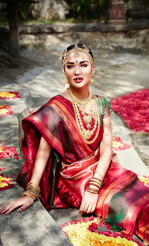South Indian bride. Temple jewelry. Jhumkis.Classic red silk kanchipuram sari.Braid with fresh flowers. Tamil bride. Telugu bride. Kannada bride. Hindu bride. Malayalee bride. Amy Jackson for Tanishq.