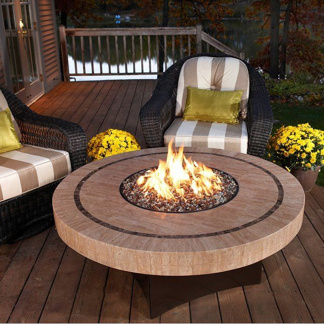 "Rethink the fire pit with the Oriflamme Sahara Round Fire Table.  The unique circular burner design is surrounded by an elegant 48"" mosaic travertine top. The durable stainless steel burner generates up to 65,000 BTUs of heat for comfortable warmth.  18 gauge, galvanized steel base with an outdoor, copper-vein powdercoated finish."