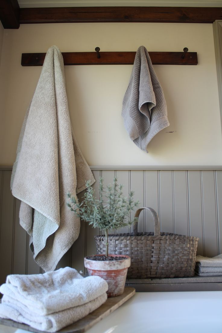 Rustic hooks will be nice in a shabby chic bathroom with wood panelling