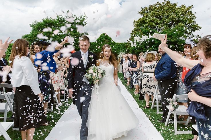 Couple having confetti thrown over them at their Notley Abbey wedding