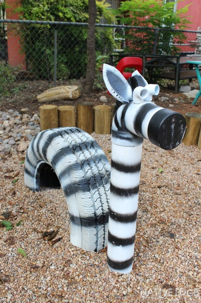 What a Zebra! This Zebra was created with an old tire and PVC. After scrubbing the tire clean to use as the main body, we managed to use one last recycled piece of PCV for the neck and head!