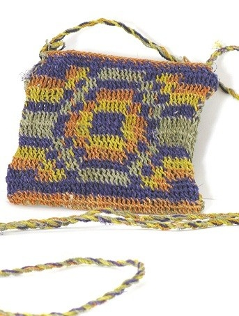 This colorful satchel is ideal to carry your cell phone or any other personal items. It has been completely handmade by the Koya tribe (Argentina) with Chaguar fibers. This natural yarn is organically colored with natural vegetable pigments obtained from local bushes and trees. This pretty sachel is a perfect eco friendly gift. This item has been woven by the female Koya artisans in purple, orange and yellow shades. Other colors, sizes and designs are also available.