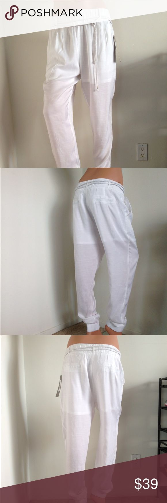"White jogger pants size small Brand: Love and Love Front pockets. Embedded shorts as lining. Pants feature wide elastic banding at cuffs and waist.  Fabric: Polyester/Spandex/Rayon (doesn't stretch) Color: White  Size Small Length: 39"" Inseam: 27"" Waist: 28"" Hips: 36"" Love and Love Pants"
