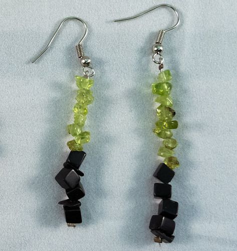 These are beautiful earrings made of Obsidian and Olivine. They measure at 4 cm.