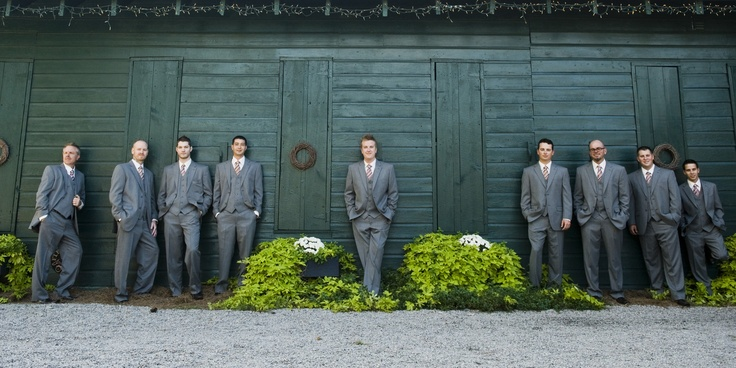 Large groomsmen bridal party, keep the groom center.    Gorgeous photo by Swank Photo Studio | http://brds.vu/xLvLyy via @BridesView #wedding #photography