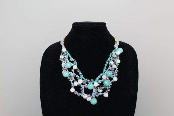 Hand made crochet bib necklace in silver & tiffany blue nylon crochet thread adorned with multi-colour blue, white, and clear beads. Necklace