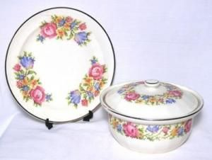 "Vintage Harker Pottery Petite Point-Harker pottery covered casserole. Classic 1940 to 50's pattern called Petite Point, which is a cross stitch floral on a white background. It is the 1.5 quart casserole. The decal is bright and intact. Silver trim on the top of casserole and cover. Measures: 8-5/8 inches in diameter, 5-1/2 inches tall with lid. The set includes matching 9"" plate. The bottom is stamped Hot Oven, Harker, The Oldest Pottery in America, Cooking Ware. $32.99"