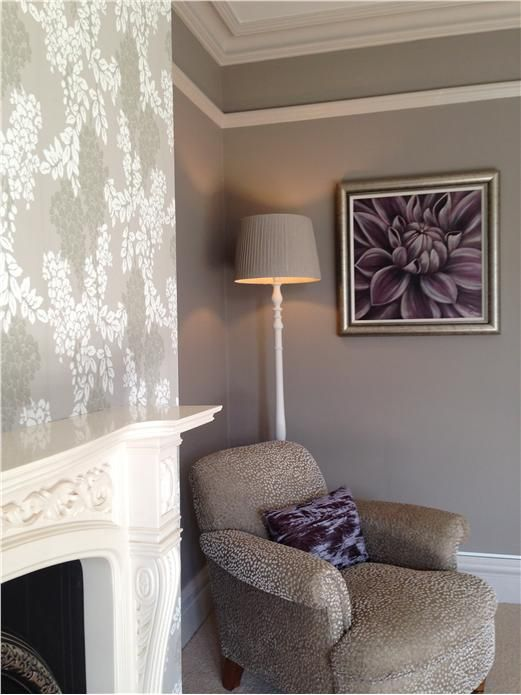 Calm neutral bedroom with chimney breast in Wisteria wallpaper, walls in Charleston Grey, all woodwork in Elephants Breath and ceiling in Strong White. An inspirational image from Farrow and Ball