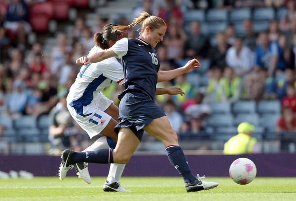 Rachel Buehler of USA is tackled by Marie-Laure Delie of France during the Womens Football first round Group G Match of the London 2012 Olympic Games between United States and France, at Hampden Park on July 25, 2012 in Glasgow, Scotland.