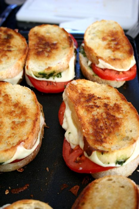 Italian Grilled Cheese: fresh bread with thinly sliced mozzarella, garden tomatoes, homemade pesto and a drizzle of olive oil.