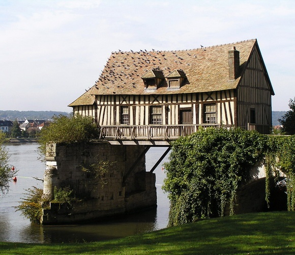 A symbol of Vernon(northern France), the old mill still lies straddling two piers of the ancient bridge over the Seine. The mill was probably built in the 16th century. It is a private property belonging to an unknown American heir. The town of Vernon had the mill renewed a few years ago.