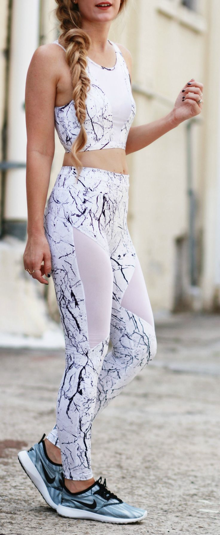 Cute work out outfit with Carbon 38 marble print leggings, sports bra, and hologram Nikes
